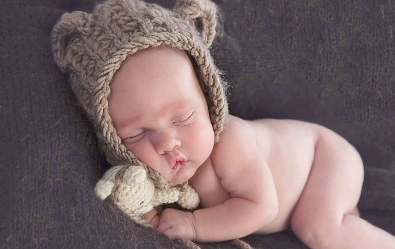 baby in bear hat