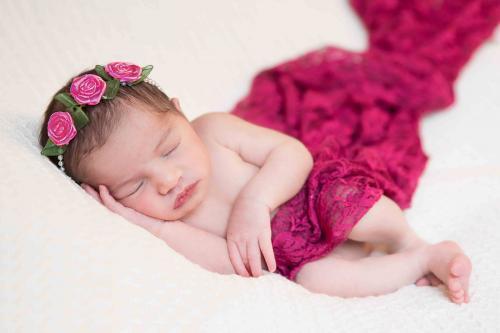 baby in dark pink