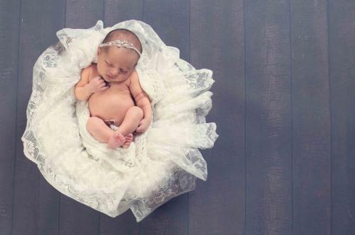 baby in lace basket