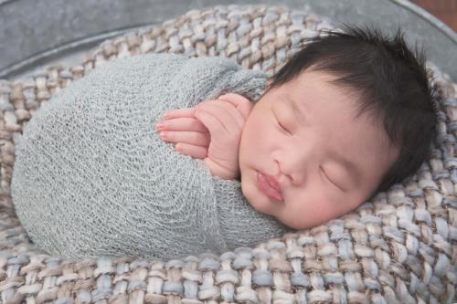 Back pose in a grey swaddle